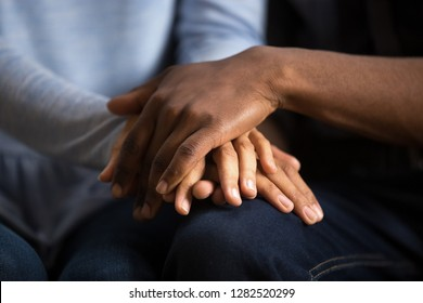 African american black couple husband and wife holding hands as psychological counseling support concept, understanding care in love, comfort empathy honesty trust in relationships, close up view
