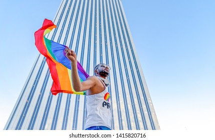 African American or black gay man vindicating the right to homosexuality with a pride flag. concept of equality and homosexuality