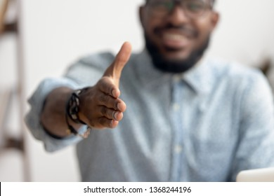 African american black professional business man hr recruiter consultant extending hand at camera for handshake concept greeting offering cooperation, welcoming at job interview, close up view