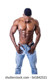 African American bodybuilder man, naked muscular torso, wearing jeans, isolated on white background, looking down