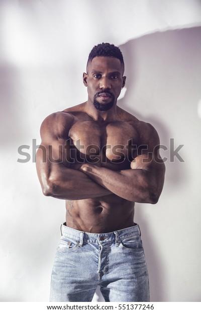 Muscular African American Man Walking Stock Photo