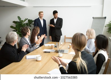 African american boss or black hr executive ceo introducing new hire employee to corporate team applauding at group meeting, office workers clapping hands welcoming coworker with friendly ovation