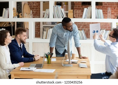 African American boss, director, mentor listening reporting about results, marketing plan, statistics employee, trainee at meeting, briefing, report with pie diagrams, graphics