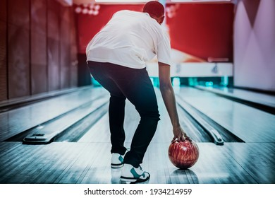 African American bowling at a hall