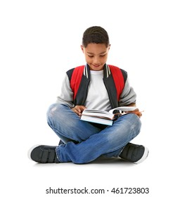 African American boy with books, isolated on white