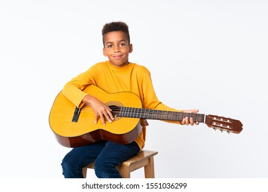 African American boy  with guitar over isolated white background