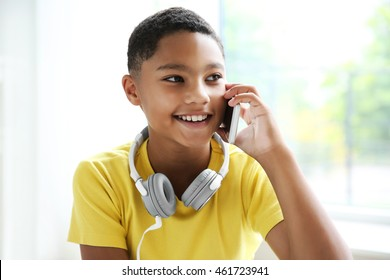 African American boy with headphones and cellphone