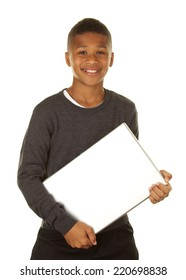 African American boy holding his laptop computer smiling