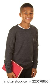 African American boy student with a book on a white background.