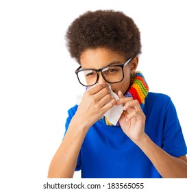 African American boy with tissue, eyeglasses and colorful scarf, concept of allergy and flu. Over white background, isolated, with copy space.