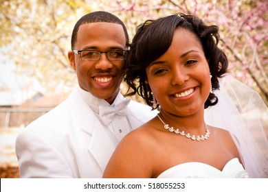 African American bride and groom on their wedding day.