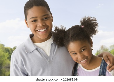 African American brother and sister hugging