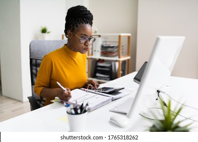 African American Business Accountant In Office Doing Accounting Work