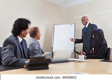 An African American business man giving a presentation to associates