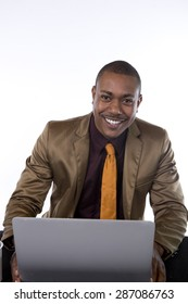 An African American business man with is laptop, smiling