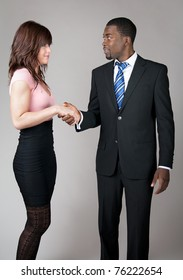 African American business man meeting a female colleague.