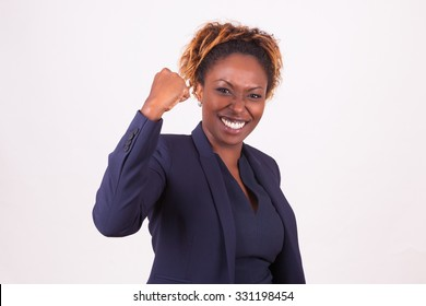 African American business woman with clenched fist, isolated on gray background