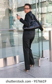An african american business woman leaving work