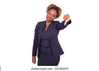 African American business woman making thumbs down gesture, isolated on white background