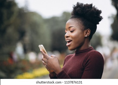 African american business woman with phone