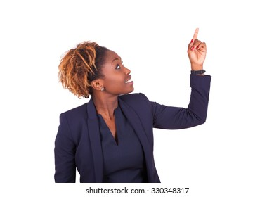 African American business woman pointing something up