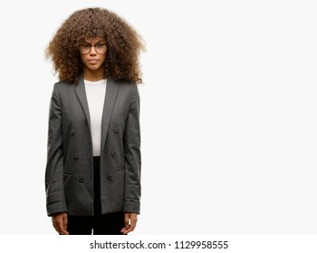 African american business woman wearing glasses skeptic and nervous, frowning upset because of problem. Negative person.