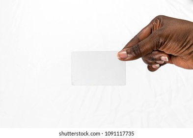 African American business woman's hand holding a blank business card or a ticket/flyer, isolated on white background for advertising mockup