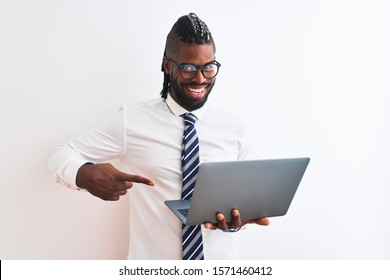 African american businessman with braids using laptop over isolated white background very happy pointing with hand and finger