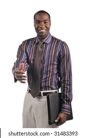 African American businessman extending a hand shake and holding a portfolio