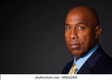 African American businessman isolated on a dark background. Leader. Successful confident businessman.