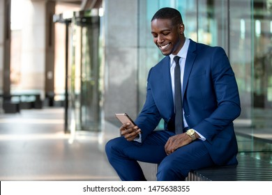 African american businessman smiling cheerful, using cell phone at office building, internet, broadband, 5G, copy space
