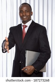 African american businessman stretching his arm