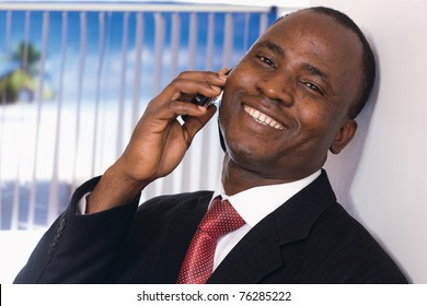 An african american businessman talking on the phone