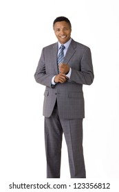 African American businessman wearing a suit and tie isolated on a white background