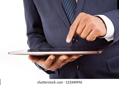 African American businessman working on a digital tablet, isolated