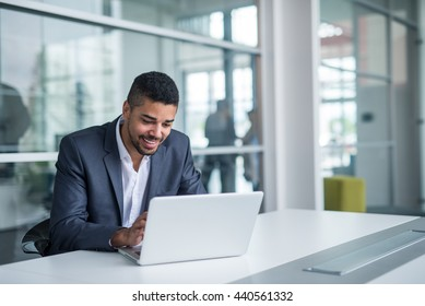 African american businessman working on a laptop.