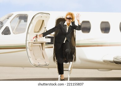 African American businesswoman getting off airplane