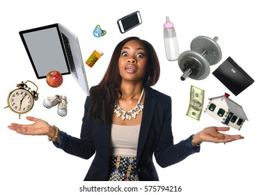 African American businesswoman juggling many objects and feeling overwhelmed
