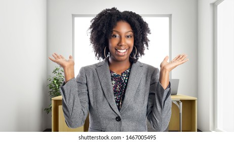 African American businesswoman in an office looking surprised.  She is an owner or an executive of the workplace.  Depicts careers and startup business.