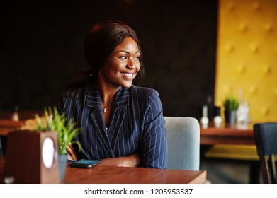 African american businesswoman sitting at table in cafe. Black girl having rest.
