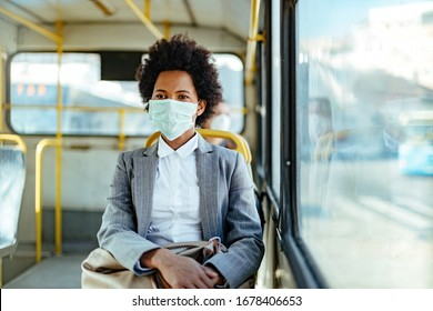 African American businesswoman wearing protective mask while traveling by public transportation.  - Shutterstock ID 1678406653