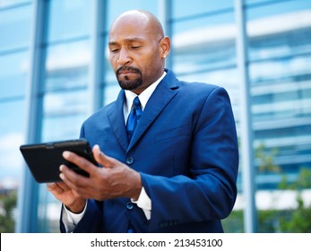african american businnesman using tablet close up