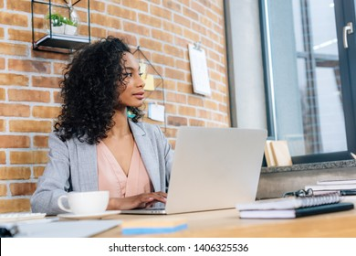 african american Casual businesswoman sitting at office desk with laptop