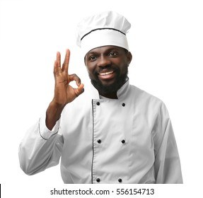 African American chef in uniform on white background