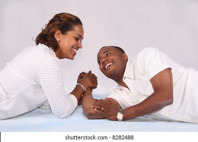 An African American couple arm enjoying a good arm wrestling challenge