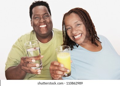 African American Couple Holding Glasses
