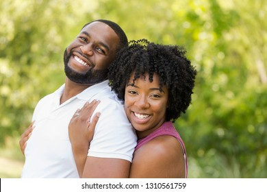African American couple laughing and smiling.