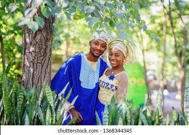 African American couple in national wedding dress in the park / African American couple wedding / copy space