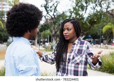 African american couple with relationship difficulties outdoors in the city