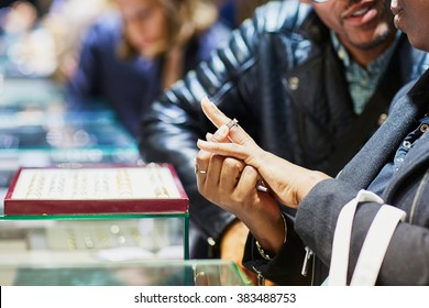 African American couple selecting a wedding ring